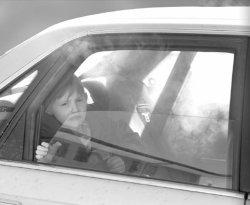 child-in-smoke-filled-car