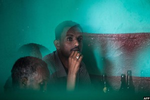 Men relax at a bar in Mekelle. The bars and cafes are no longer smoke-filled.