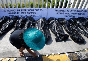 Protesters displayed fake body bags at a tobacco trade show at Pasay, the Philippines, in 2013.