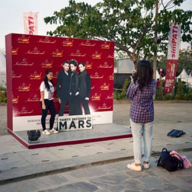 Girls taking photos at a tobacco-sponsored exhibit during the 2011 Java Rockin' Land concert, sponsored by the Gudang Garam cigarette brand. The 3-days event in Indonesia drew performers such as The Cranberries, Thirty Seconds to Mars, The Dirty Radicals and Good Charlotte. Tobacco companies are among the leading sponsors of live music events in Indonesia  Rocco Rorandelli