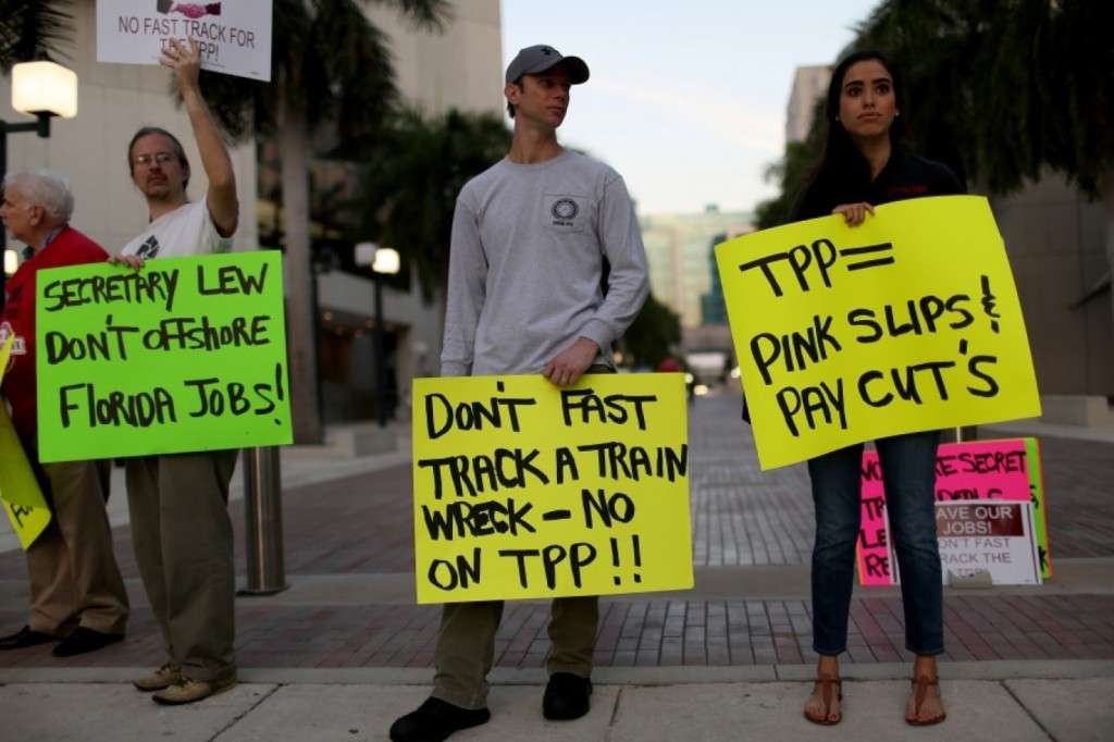 Union members and community activists protest outside the Miami Dade College, where the Greater Miami Chamber of Commerce and the college were hosting a moderated conversation with Treasury Secretary Jack Lew on March 20, 2015. The protesters are against the Trans-Pacific Partnership, a proposed 12-nation pact. (Joe Raedle/Getty Images)
