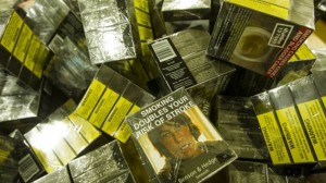 A pile of cigarette packets with plain packaging. Photo: Nic Walker