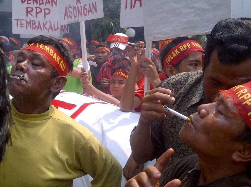Indonesian cigarette vendors at a recent rally in Jakarta, protesting government talks over a tobacco-control law. Thousands of vendors were organized and deployed by an Indonesian tobacco trade group.