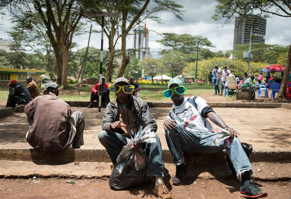 Smoking in public areas in highly restricted in Kenya. These two men sit back in one of central Nairobi's smoking zones, as designated by the country's ministry of health. Photograph: David Levene for the Guardian