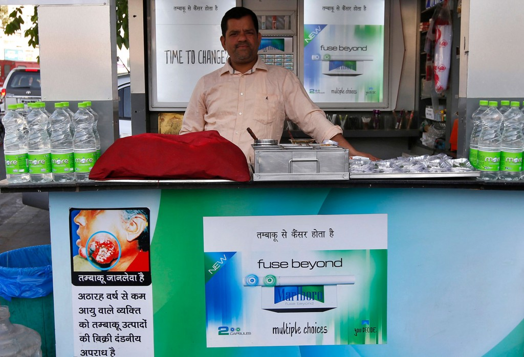 STOREFRONT ADS: Marlboro advertisements can be seen on this kiosk in a marketplace in New Delhi in April. Despite warnings from health officials, Philip Morris has continued to advertise its Marlboro cigarettes. REUTERS/Adnan Abidi